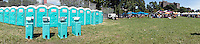 A line of portable toilets, seen at a festival in Commodore Barry Park in the Fort Greene neighborhood of Brooklyn in New York on Sunday, August 26, 2012.  (© Frances M. Roberts)
