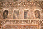 North Africa, Morocco, Marrakesh. Inscriptions and detail of carvings in the facade of the Ben Youseef Madrassa.
