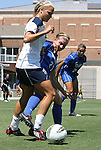 28 August 2011: Notre Dame's Melissa Henderson (left) and Duke's Alex Straton (27). The Duke University Blue Devils defeated the Fighting Irish of Notre Dame 3-1 at Fetzer Field in Chapel Hill, North Carolina in an NCAA Women's Soccer game.