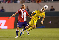 Columbus Crew defender Chad Marshall (14) moves past Chivas USA forward Justin Braun (17). CD Chivas USA defeated the Columbus Crew 3-1 at Home Depot Center stadium in Carson, California on Saturday July 31, 2010.