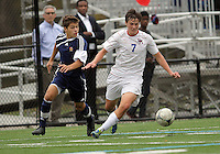 HYATTSVILLE, MD - OCTOBER 26, 2012:  Christian Cooke (7) of DeMatha Catholic High School moves the ball away from Chris Fleisher (25) of St. Albans during a match at Heurich Field in Hyattsville, MD. on October 26. DeMatha won 2-0.