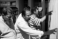 Moussayib, Iraq, May 24, 2003.People reading descriptions of clothing and personal belongings from more than 400 bodies from persons missing since their arrest by Hussein Kamal, Saddam's son-in-law and his men, in March 1991. the bodies were found in mass-graves in Djur Al Saher and have been brought to a theater hall in Moussayib to allow identification by the families. .
