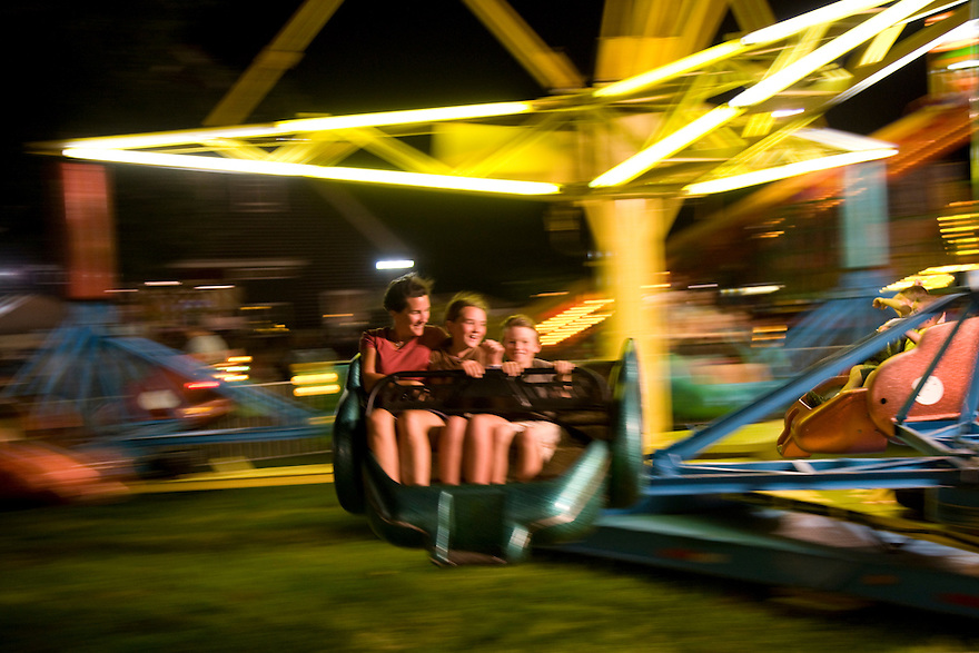 Amusement rides at the 147th Martha's Vineyard Agricultural Society Fair .   The annual event brought traditional livestock contests, racing pigs, rides and more to island off Cape Cod in Massachusetts.......................