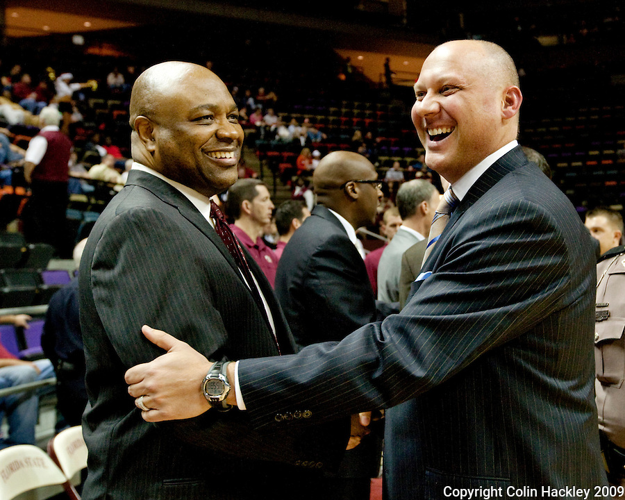 TALLAHASSEE, FL 12/11/09-FSU-AU BB09 CH02-Florida State Head Coach Leonard Hamilton, left, greets Auburn Head Coach Jeff Lebo prior to the game Thursday at the Donald L. Tucker Center in Tallahassee...COLIN HACKLEY PHOTO