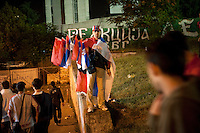 A man sells Serbian flags outside the stadium of football team Red Star Belgrade. Witnesses have reported seeing former Bosnian Serb general Ratko Mladic attending football matches at this stadium despite that he was being sought by the UN war crimes tribunal on charges of genocide and crimes against humanity.