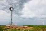 Storm clouds and windmill on prairie