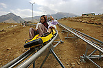 Iraqis from Baghdad, who arrived after taking an overnight bus, enjoy a new rollercoaster at a new vacation development near the Bekhal waterfalls in Kurdistan. Although international tourism is almost non-existent, Kurdistan is a major destination for Iraqis seeking to escape the violence that has plagued the country follwing the US invasion in 2003...Stability and security prevail in postwar Iraqi Kurdistan as Iraqi tourists, many of them from Baghdad, flock to the northern cities and their amusement parks and national parks to escape violence and sectarian strife in the central and southern regions of the country.
