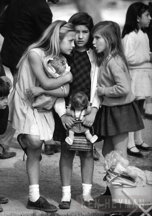 In Seville, Spain, daughters of servicemen gossip.