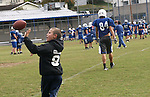 Charles Andrew Collins, 11, catches a football at practice on Wednesday Oct. 12, 2011 at Breathitt County High School in Jackson, Ky. Collins attends mosts practices and assists the team with water and equipment. Photo by Rachel Aretakis