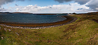 Panorama image of Loch Dunvegan, Isle of Skye, Scotland. .The Island visible in the center of the image is Lampay, a tidal island reachable in low tide. On the left, the promontory is Dunvegan Head. The small stretch of white beach on the right is part of the Coral Beaches of Skye, a mass of (not coral) but dissicated algae (Maerl - Lithothamnion) mixed with small shells, and unique on this island. Just beyond it, the Isle of Isay (Iosaigh in Gaelic) can be seen.