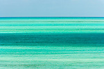 The beautiful waters of the Caribbean Sea are captured in this simple composition photographed from the isle of Ambergris Cay.  The aquamarine bands of color convey a sense of place while maintaining a strict minimalism.