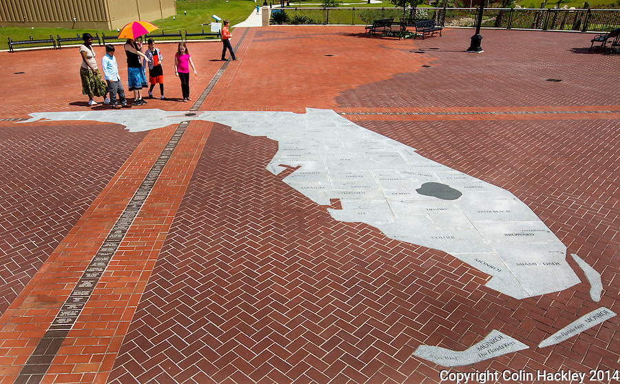 Visitors to Cascades walk along a map that contains Florida's prime meridian marker, the point from which all land surveys in the state are measured.<br /> <br /> COLIN HACKLEY PHOTO