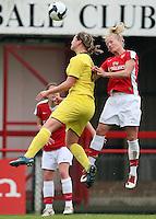 Katie Chapman of Arsenal heads clear from Michaela Culova - Boreham Wood FC - 11/11/09 - MANDATORY CREDIT: Gavin Ellis/TGSPHOTO - Self billing applies where appropriate - Tel: 0845 094 6026