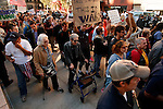 NewYork, United States, October 05, 2011..Protesters affiliated with the Occupy Wall Street movement march in Lower Manhattan's Financial District near Wall Street in New York October 5, 2011. VIEWpress / Kena Betancur.Thousands of protesters including union members and college students from an organized walkout joined today's rally and march..Local media reported.