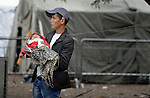 A man holds his child inside a refugee processing center in the Serbian village of Presevo, not far from the Macedonian border. Hundreds of thousands of refugees and migrants--including many children--have flowed through Serbia in 2015, on their way from Syria, Iraq and other countries to western Europe.