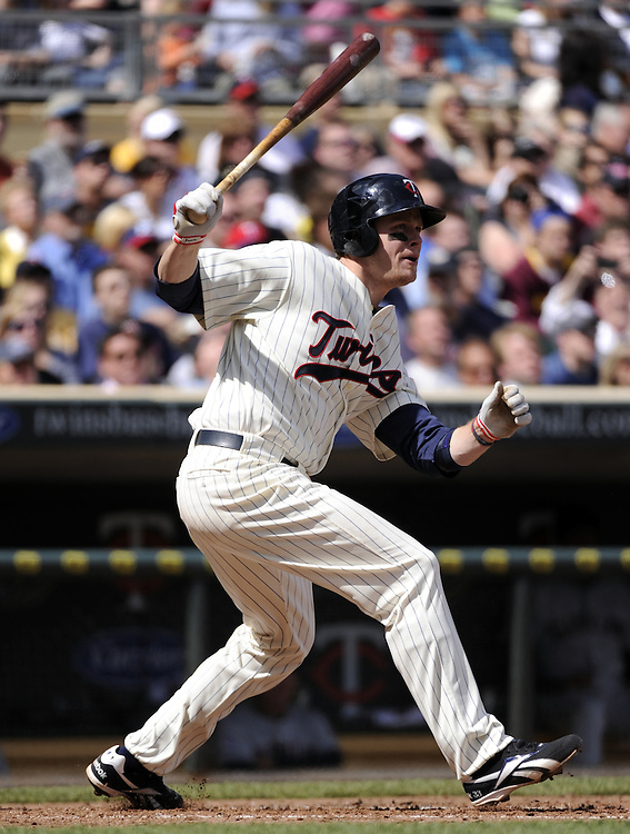 MINNEAPOLIS - APRIL 24:  Justin Morneau #33 of the Minnesota Twins bats against the Cleveland Indians on April 24, 2011 at Target Field in Minneapolis, Minnesota.  The Twins defeated the Indians 4-3.  (Photo by Ron Vesely)  Subject:  Justin Morneau