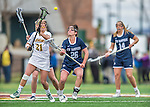 25 April 2015: University of Vermont Catamount Attacker Jessica Roach, a Senior from Scituate, MA, takes possession from University of New Hampshire Wildcat Attacker Emma Kriss, a Senior from Rockville Centre, NY, during game action at Virtue Field in Burlington, Vermont. Roach scored 3 goals as the Lady Catamounts defeated the Lady Wildcats 12-10 in the final game of the season, advancing to the America East playoffs. Mandatory Credit: Ed Wolfstein Photo *** RAW (NEF) Image File Available ***