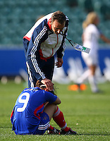 Pauline Crammer is consoled by coach Gerard Sergent..FIFA U17 Women's World Cup, USA v France, Albany Stadium, Auckland, New Zealand, Wednesday 5 November 2008. Photo: Renee McKay/PHOTOSPORT