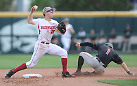 NWA Democrat-Gazette/ANDY SHUPE<br />Arkansas second baseman Carson Shaddy (left) makes the relay throw to first after forcing out Georgia center fielder Tucker Maxwell Saturday, April 15, 2017, to end a threat during the fourth inning at Baum Stadium in Fayetteville. Visit nwadg.com/photos to see more photographs from the game.