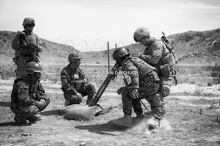 Afghan National Army soldiers conduct a live fire exercise with their mortars in Panjwayi, Kandahar, under the watchful eye of their US counterparts from 1st Battalion, 38th Infantry Regiment. (John D McHugh)