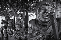 """A black and white view of the bronze """"Our Game"""" sculpture in front of the Hockey Hall of Fame in Toronto."""