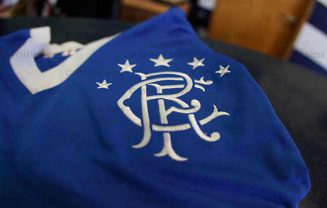 Rangers crest on the 2011-12 home shirt at the training ground for the start of the new season