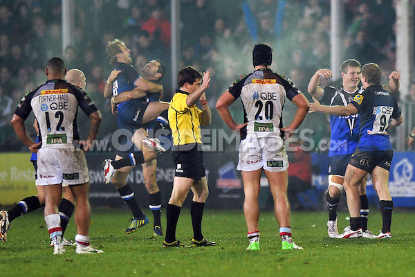 Bath players celebrate at the final whistle. Aviva Premiership match, between Bath Rugby and Harlequins on November 23, 2012 at the Recreation Ground in Bath, England. Photo by: Patrick Khachfe / Onside Images