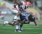 Georgia tight end Orson Charles (7) is tackled by Mississippi's Charles Sawyer (3) at Vaught-Hemingway Stadium in Oxford, Miss. on Saturday, September 24, 2011. Georgia won 27-13. (AP Photo/Oxford Eagle, Bruce Newman)..