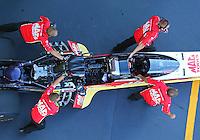 Jun 17, 2016; Bristol, TN, USA; Crew members push the car of NHRA top fuel driver Doug Kalitta during qualifying for the Thunder Valley Nationals at Bristol Dragway. Mandatory Credit: Mark J. Rebilas-USA TODAY Sports