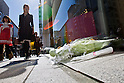 October 6, 2011: Tokyo, Japan - Flowers are left for the late Steve Jobs, founder and former CEO of Apple Inc., outside the Apple store in the Ginza shopping district of Tokyo. Jobs passed away in the United States at the age of 56 after a long battle with cancer. (Photo by Christopher Jue/AFLO)