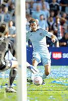 Sporting KC midfielder Graham Zusi drives at the Red Bulls goal...Sporting Kansas City defeated New York Red Bulls 2-0 at LIVESTRONG Sporting Park, Kansas City, Kansas.