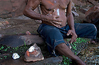Rain ceremony by one of the local aborigines who paints his body for the ritual.