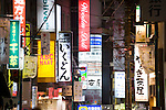 Photo shows neon signs along the main shopping street of central Shimokitazawa, Setagaya Ward, Tokyo, Japan..Photographer: Robert Gilhooly