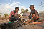 Beola Sandik (left) and her cousin Moses Luate sit by the fire early in the morning in the Southern Sudan village of Kupera. The children and their families returned from refugee camps in neighboring Uganda in 2006. NOTE: In July 2011, Southern Sudan became the independent country of South Sudan