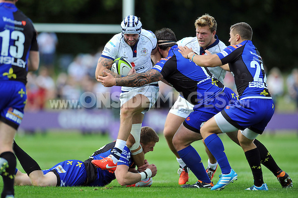 Ryan Edwards takes on the Dragons defence. Pre-season friendly match, between Bristol Rugby and Newport Gwent Dragons on August 17, 2014 at the Cribbs Causeway Ground in Bristol, England. Photo by: Patrick Khachfe / JMP