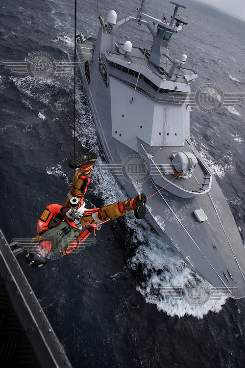 Air operations with Westland Lynx helicopter. Rescue swimmer being hoisted from Coastguard vessel during training. Coastguard vessel KV Svalbard patrols the northermost waters of Norway, including around the islands that she is named after. The main task is inspecting fishing boats, but she also performs search and rescue missions, and environmental monitoring. © Fredrik Naumann