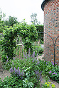 Oast house garden, Tidebrook Manor, East Sussex, early June.