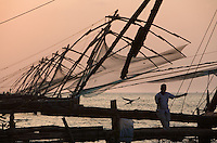 20080202_Fort Kochin, India_ People stand on what's know as the Chinese Fishing Nets in Fort Kochin, which is located in the Southern Indian state of Kerala.  Photographer: Daniel J. Groshong/Tayo Photo Group