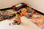QAIM, IRAQ: Syrian children in a disused building at the Qaim refugee camp in Iraq...Over 4,450 Syrian refugees have fled the violence in Syria and are living in the Qaim refugee camp in Iraq...Photo by Ali Arkady/Metrography