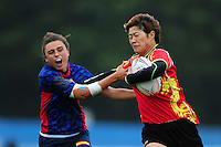 Yuanyuan Lu of PR China takes on the Spain defence. FISU World University Championship Rugby Sevens Women's 7th/8th place match between Spain and PR China on July 9, 2016 at the Swansea University International Sports Village in Swansea, Wales. Photo by: Patrick Khachfe / Onside Images