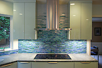 Mist, a hand cut jewel glass mosaic, shown in blue, white and green 1.5cm stalks.<br />