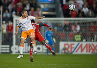07 May2011: Houston Dynamo forward Koke #27 and Toronto FC midfielder Julian de Guzman #6 in action during an MLS game between the Houston Dynamo and the Toronto FC at BMO Field in Toronto, Ontario..Toronto FC won 2-1.