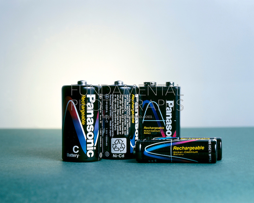 BATTERIES<br /> Rechargeable nickel cadmium<br /> A battery that uses nickel oxide in its positive electrode (cathode), a cadmium compound in its negative electrode (anode), and potassium hydroxide solution in its electrolyte.  NiCd batteries are rechargeable.