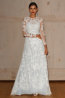 Model poses in an Oleg Cassini bridal gown for the David's Bridal Fall 2017 fashion show presentation on April 19, 2017; during New York Bridal Fashion Week.