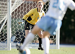 Florida State goalkeeper Ali Mims (0) keeps a close on UNC's Lindsay Tarpley (25) on Friday, November 25th, 2005 at Fetzer Field in Chapel Hill, North Carolina. The Florida State Seminoles defeated the University of North Carolina Tarheels 5-4 on penalty kicks after the teams tied 1-1 after overtime during their NCAA Women's Soccer Tournament quarterfinal game.