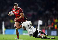 Jonny May of England is tackled by Ben Volavola of Fiji. Rugby World Cup Pool A match between England and Fiji on September 18, 2015 at Twickenham Stadium in London, England. Photo by: Patrick Khachfe / Onside Images