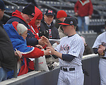 Former Ole Miss baseball player Matt Tolbert signs autographs at the Ole Miss baseball alumni game at Oxford-University Stadium in Oxford, Miss. on Saturday, February 5, 2011.