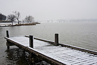Snow covered pier on White Rock Lake in Dallas, Texas during a rare winter snowfall in February 2010.