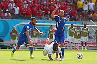 Joel Campbell of Costa Rica goes down under the challenge of Giorgio Chiellini of Italy in the penalty area but no penalty is awarded