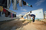 Basil al Ahman waters the plants around his home in the Zaatari refugee camp near Mafraq, Jordan. Established in 2012 as Syrian refugees poured across the border, the camp held more than 80,000 refugees by 2015, and was rapidly evolving into a permanent settlement, with many refugees moving out of tents and into modular houses. The ACT Alliance provides a variety of services to refugees living in the camp.